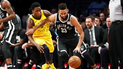 Brooklyn Nets shooting guard Allen Crabbe (right) defending ball against Indiana Pacers guard Victor Oladipo