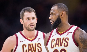 Cleveland Cavaliers PF/center (l) talking with teammate LeBron James.