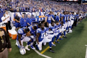 Indianapolis Colts players kneel during the national anthem to protest Donald Trump's comments about NFL players.