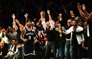 Kyrie Irving receives praise from Brooklyn Nets' fans after hitting a clutch 3-pointer in the closing seconds of a game against the New York Knicks on October 25, 2019, at the Barclays Center