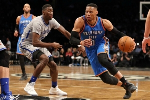 Brooklyn Nets rookie Caris Levert guarding Oklahoma City Thunder's Russell Westbrook during a game at the Barclays Center on March 14, 2017