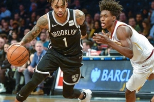 D'Angelo Russell, Brooklyn Nets guard, pushing past Cleveland Cavaliers guard Collin Sexton on December 3, 2018, at the Barclays Center