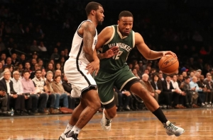 Sean Kilpatrick Nets shooting guard defending against Bucks forward Jabari Parker (12)