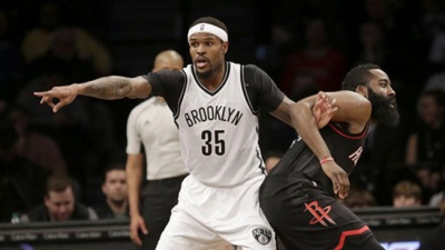 Brooklyn Nets forward, Trevor Booker (left), entangled with Houston Rockets guard James Harden during the first half of game at Barclays Center on January 15, 2017.
