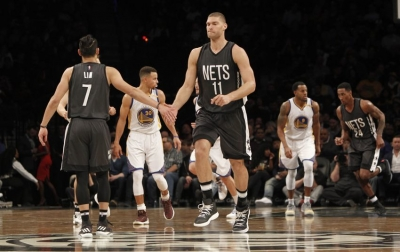 Photo  Brooklyn Nets guard Jeremy Lin (7) and Nets center Brook Lopez acknowledge a great play in first-half of game against the Golden State Warriors at the Barclays Center on December 22, 2016.