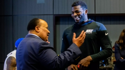Martin Luther King talking with a member of the NY Giants at a civic engagement event sponsored by RISE, a nonprofit organization founded by Miami Dolphins owner Stephen M. Ross