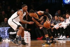 Brooklyn Nets forward Joe Johnson defending against Indiana Pacers forward Paul George