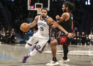 Brooklyn Nets guard Spencer Dinwiddie (left) breezes by Chicago Bulls guard Colby White at an NBA game at the Barclays Center in Brooklyn, NY on March 8, 2020. The Brooklyn Nets defeated the Chicago Bulls 110-107.
