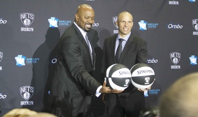 Billy King (left), Brooklyn Nets general manager introducing Jason Kidd, Brooklyn Nets' new head coach, to the media