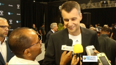 Brooklyn Nets owner Mikhail Prokhorov talking to What's The 411 reporter Andrew Rosario