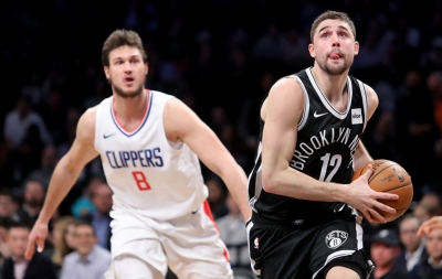 Brooklyn Nets shooting guard Joe Harris (right) has his eyes on the basket, while Los Angeles Clippers Danilo Gallinari (No. 8 on left) looks on.