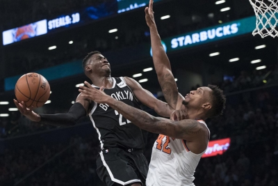Brooklyn Nets guard Caris LeVert drives a jump shot over New York Knicks forward Lance Thomas to put the Nets up 107-105 over the Knicks with one second left in regulation for the eventual win.