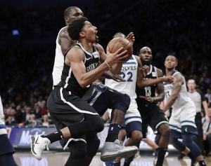 Brooklyn Nets' Spencer Dinwiddie, left, drives past Minnesota Timberwolves' Gorgui Dieng during an NBA basketball game on Wednesday, Jan. 3, 2018, at the Barclays Center in Brooklyn, New York. The Nets won 98-97.