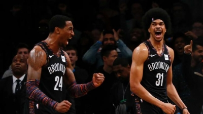 Brooklyn Nets forward Rondae Hollis-Jefferson (left) and Brooklyn Nets center Jarrett Allen (right) jubilant after defeating the Toronto Raptors 106-105 in overtime at Barclays Center.