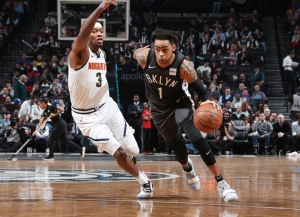 Brooklyn Nets point guard D'Angelo Russell whizzes by Denver Nuggets forward Torrey Craig at Barclays Center on February 6, 2019. Brooklyn Nets defeated the Denver Nuggets 135-130