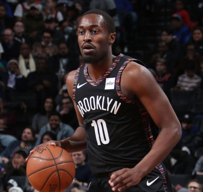 Brooklyn Nets guard Theo Pinson re-signs with the Nets.