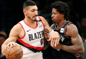 Ed Davis, Brooklyn Nets center (right), defending against Portland Trail Blazers center Enes Kanter