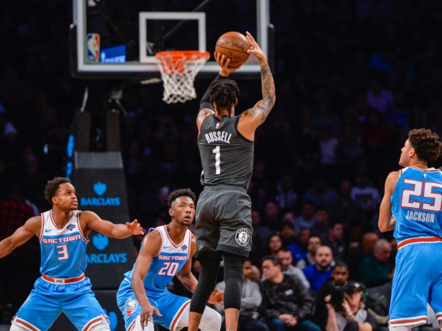 NBA Basketball: Brooklyn Nets guard D'Angelo Russell (1) shoots a jumper over Sacramento Kings, on Monday, Jan. 21, 2019, in New York.