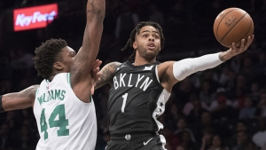 Brooklyn Nets point guard D'Angelo Russell, holds off defense from Robert Williams III in a game against the Boston Celtics at the Barclays Center on March 30, 2019. The Brooklyn Nets defeated the Boston Celtics 110-96.