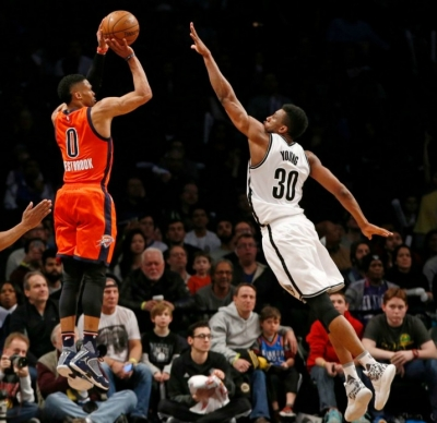 Thaddeus Young Brooklyn Nets forward defending basket against OKC guard Russell Westbrook