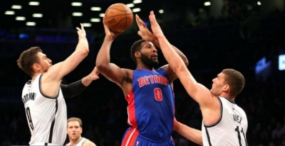 Brooklyn Nets forward/center Andrea Bargnani (9) and center Brook Lopez (11) are defending against Detroit Pistons center Andre Drummond (0) at Barclays Center.