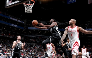 Brooklyn Nets forward DeMarre Carroll takes the ball to the hole while Houston Rockets forward PJ Tucker looks on in a game at the Barclays Center on Tuesday, February 6, 2018
