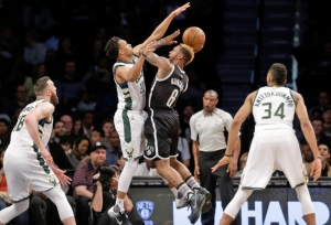 Nets guard Sean Kilpatrick (6) looks to pass around Bucks guard Rashad Vaughn during the first half of Nets meeting with Bucks on March 13, 2016. The Bucks defeated the Nets 109-100.