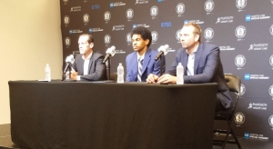 Jarrett Allen (center) with Nets head coach Kenny Atkinson (left) and Nets general manager Sean Marks