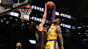 Brooklyn Nets center Jarrett Allen (left) makes history blocking a dunk by Los Angeles Lakers forward LeBron James, only one of eight NBA players to do so in 1,850 dunk attempts.
