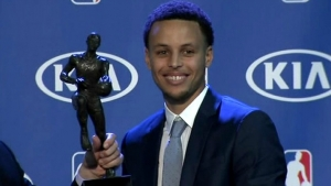 Golden State warriors guard Stephen Curry wins the NBA MVP award for a second consecutive year and is the first person to win with a unanimous vote