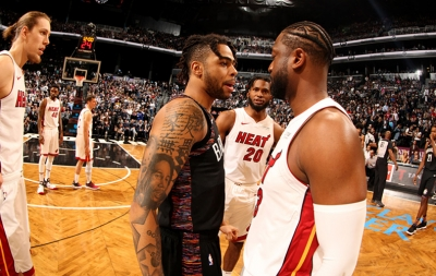 Brooklyn Nets guard D'Angelo Russell (left) talking with Miami Heat guard Dwyane Wade on the court at the Barclays Center in Brooklyn, NY. Brooklyn Nets defeats Miami Heat 113-94 on the last day of Dwyane Wade's career as an NBA basketball player.