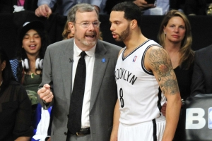 Brooklyn Nets interim head coach PJ Carlesimo (l) talking with Nets point guard Deron Williams