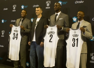 Photo (l to r): Paul Pierce, Brooklyn Nets owner, Mikhail Prokhorov; Kevin Garnett, and Jason Terry
