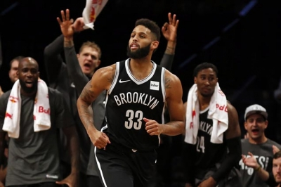 Brooklyn Nets shooting guard Allen Crabbe in front of the Nets' bench.