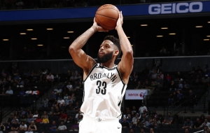 Brooklyn Nets guard/forward Allen Crabbe taking a jump shot in a game against the New York Knicks on Sunday, October 8, 2017. Crabbe scored 11 points in six minutes against the New York Knicks on Sunday.