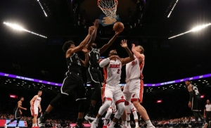 DeMarre Carroll (2nd from left) fights for rebound against Miami Heat