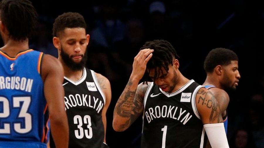Brooklyn Nets guards Allen Crabbe (left) and D'Angelo Russell (right) recognizing that game against the Oklahoma City Thunder is getting away from them