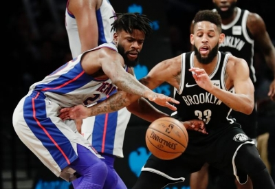 Brooklyn Nets' Allen Crabbe and Detroit Pistons' Reggie Bullock struggle for control of the ball.