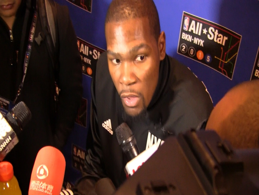 Kevin Durant talking with reporters during NBA All-Star