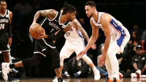 Brooklyn Nets guard, D'Angelo Russell moving past Philadelphia 76ers guard, Ben Simmons at the Barclays Center on Sunday, November 25, 2018.