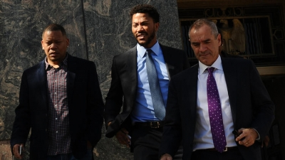 Derrick Rose (center) leaving court in Los Angeles after being found not liable in civil lawsuit for sexual assault