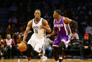 Brooklyn Nets Isaiah Whitehead dribbles past Sacramento's Darren Collison in game on November 27, 2016
