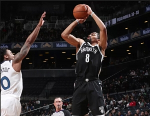 Brooklyn Nets guard Spencer Dinwiddie scoring over Minnesota Timberwolves guard Jeff Teague at a game at the Barclays Center on Friday, November 23, 2018