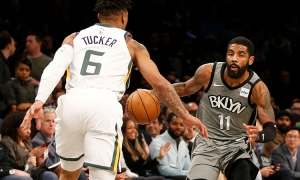 Brooklyn Nets guard Kyrie Irving with the ball, while Utah Jazz rookie guard/forward, Rayjon Tucker tries to defend in a game at the Barclays Center on Tuesday, January 14, 2010. The Brooklyn Nets lost to the Utah Jazz 118-107.