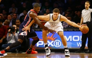 Brook Lopez dribbles ball past Wizards defender Andrew Nicholson (44) during first half on Monday, December 5, 2016