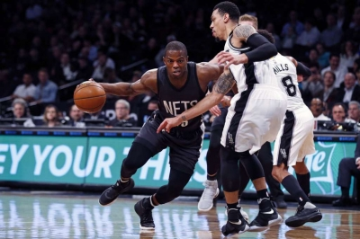 Brooklyn Nets guard Isaiah Whitehead drives to the basket defended by San Antonio Spurs guard Danny Green
