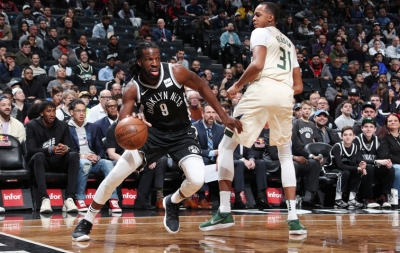 DeMarre Carroll, Brooklyn Nets forward, gets by Milwaukee Bucks center John Henson at game at the Barclays Center in Brooklyn on February 4, 2018.
