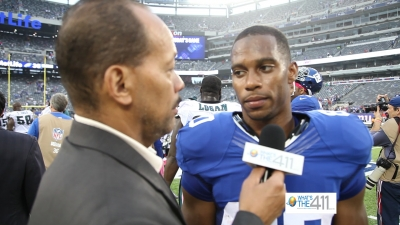 Andrew Rosario talking with New York Giants wide receiver Victor Cruz