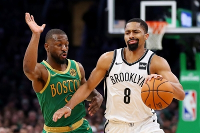 Brooklyn Nets point guard Spencer Dinwiddie holds off Kemba Walker, Boston Celtics point guard during a game at the Barclays Center on Friday, November 29, 2019. The Brooklyn Nets defeated the Boston Celtics 112-107.