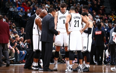 Brooklyn Nets head coach Lionel Hollins talking with his team during a timeout of the Nets game against the Dallas Mavericks at Barclays Center on December 23, 2015.